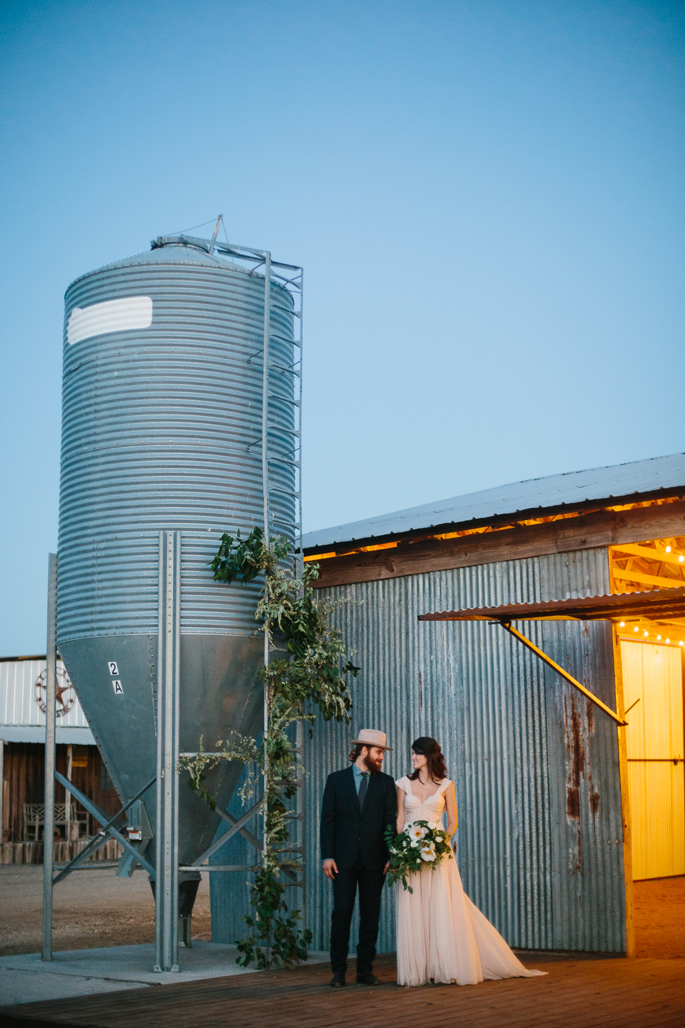 Towers with beautiful floral installation at a Dallas ranch wedding.
