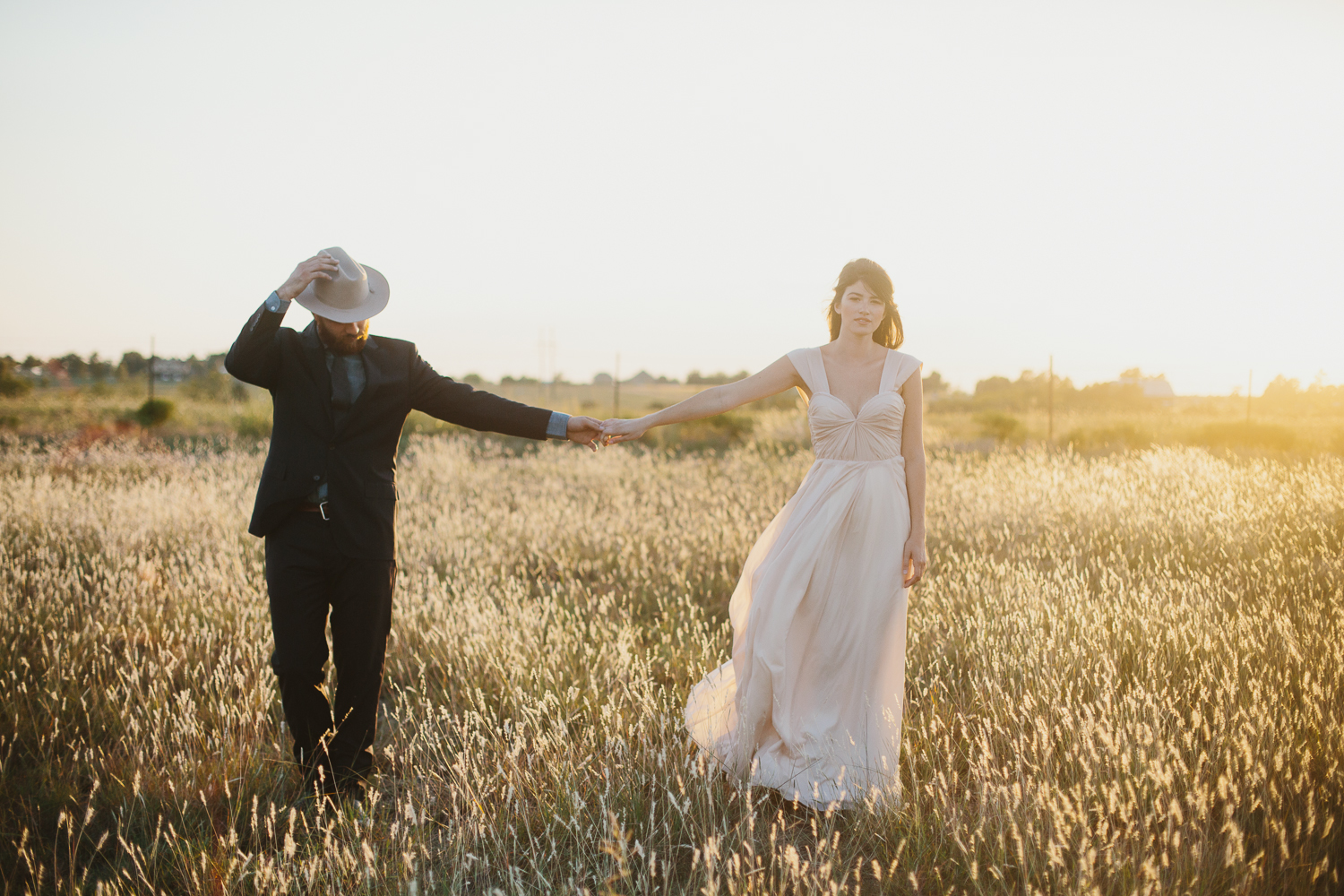 Bride and Groom in the beautiful fields of Dallas ranch wedding venue, Summerfield.